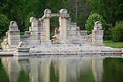 Photograph of the reflection of white stone pillars with model in back ground at Tower Grove fountain taken by Leandra Melgreen Lewis.