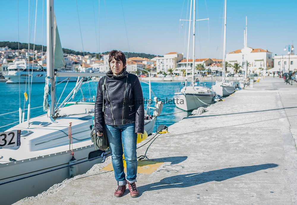 """Lena, original from Lesbos, founder of the local greek NGO """"Lesbos Solidarity"""". Here photographed in the harbour of Mytilene, capital and main town of Lesbos island"""