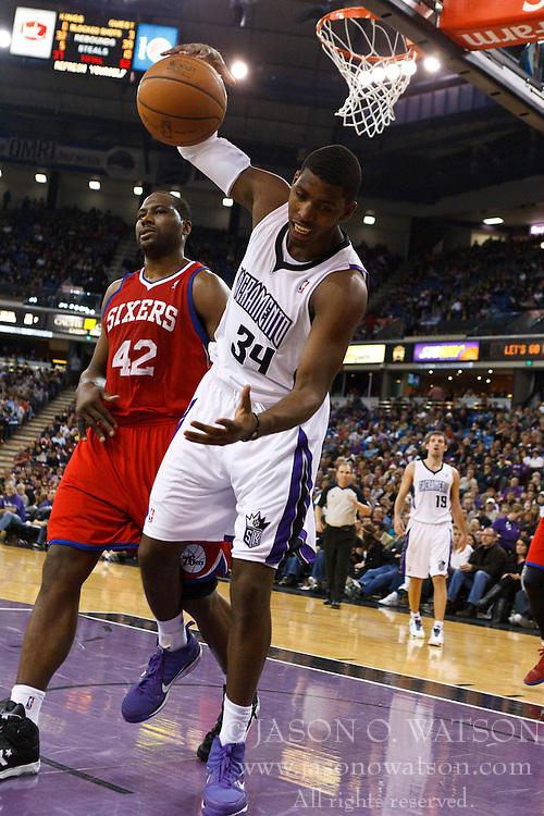 March 18, 2011; Sacramento, CA, USA;  Sacramento Kings center Jason Thompson (34) is fouled by Philadelphia 76ers power forward Elton Brand (42) during the third quarter at the Power Balance Pavilion. Philadelphia defeated Sacramento 102-80.