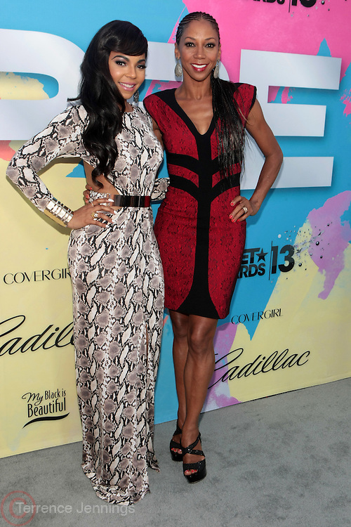 "Los Angeles, CA-June 29:  (L-R) Recording Artist/Actress Ashanti Shequoiya Douglas and Actress Holly Robinson-Peete attend the Seventh Annual "" Pre "" Dinner celebrating BET Awards hosted by BET Network/CEO Debra L. Lee held at Miulk Studios on June 29, 2013 in Los Angeles, CA. © Terrence Jennings"