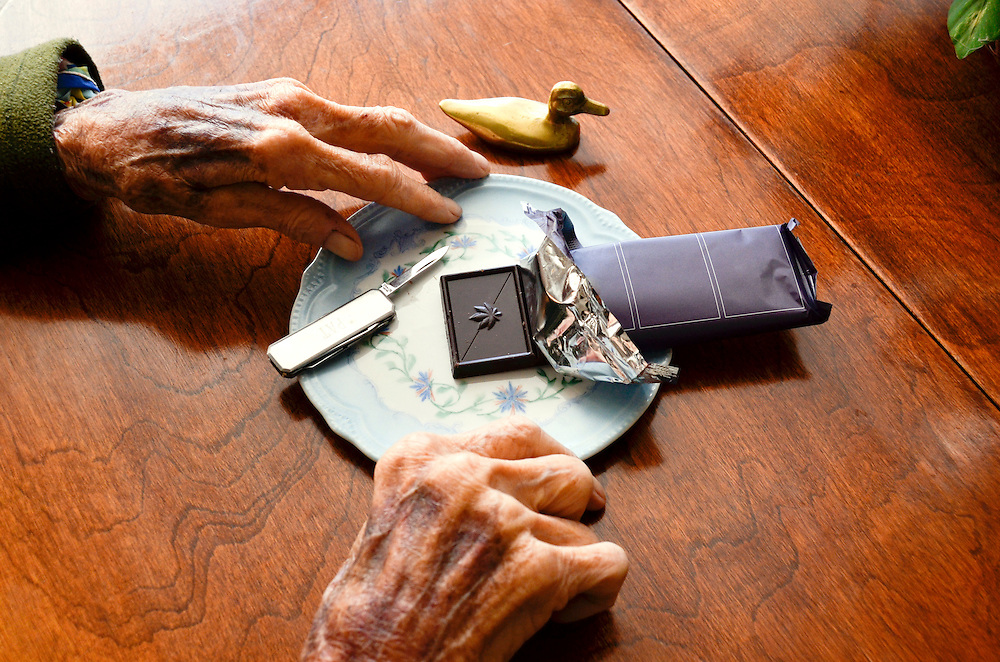 Elderly woman with cannabis edibles in her own home.