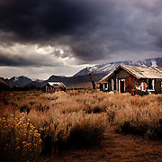 Storm clouds over abandoned house in High Sierras