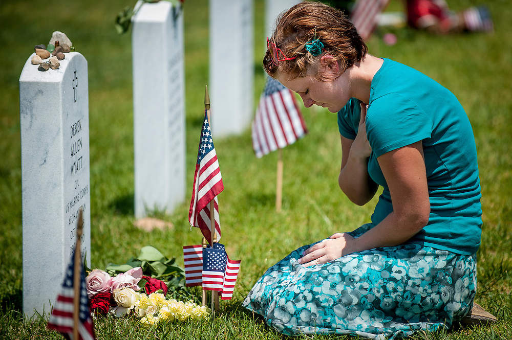 Melissa Sherman of Akron, OH, mourns at the grave of her stepbrother, Marine CPL Derek Allen Wyatt on Memorial Day at Arlington National Cemetery in Arlington, VA, USA on 28 May, 2012.