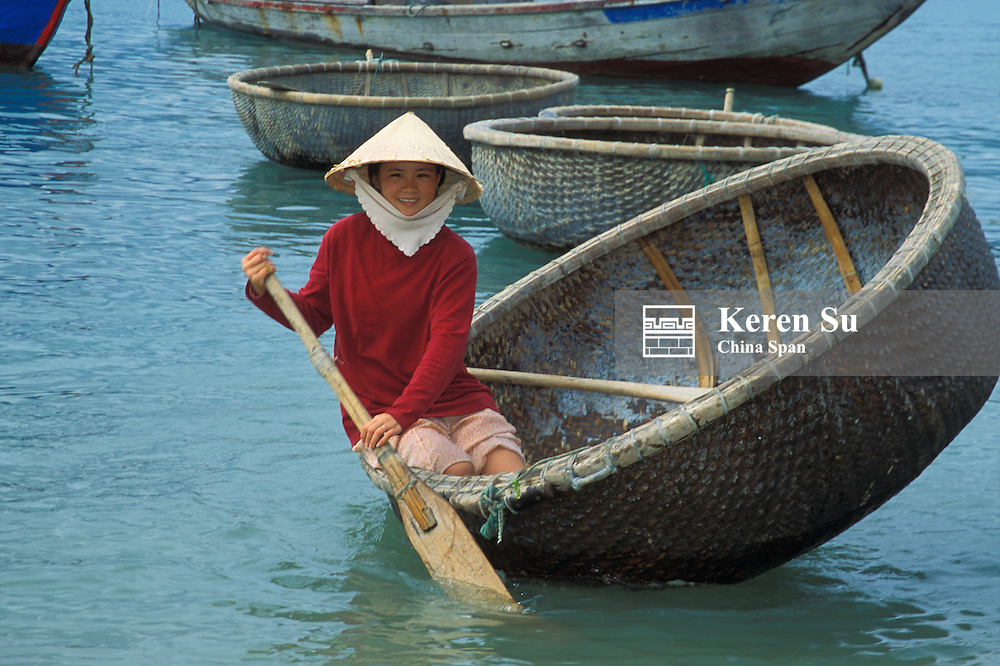 Vietnamese girl in basket boat, Nha Trang, Vietnam