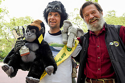 """© Licensed to London News Pictures. 29/04/2017. London, UK. Met Police officer Tom Harrison, 41, known as """"Mr Gorilla"""", celebrates with Ian Redmond, Chairman of The Gorilla Organisation, after finally completing the London Marathon after six days of crawling and raising £23,900 for The Gorilla Organisation.   Photo credit : Stephen Chung/LNP"""