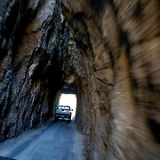 Driving through one of the many tunnels in Custer State Park in South Dakota. .