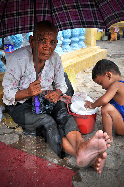 Homeless family in a street of Phnom Penh, Cambodia, Southeast Asia