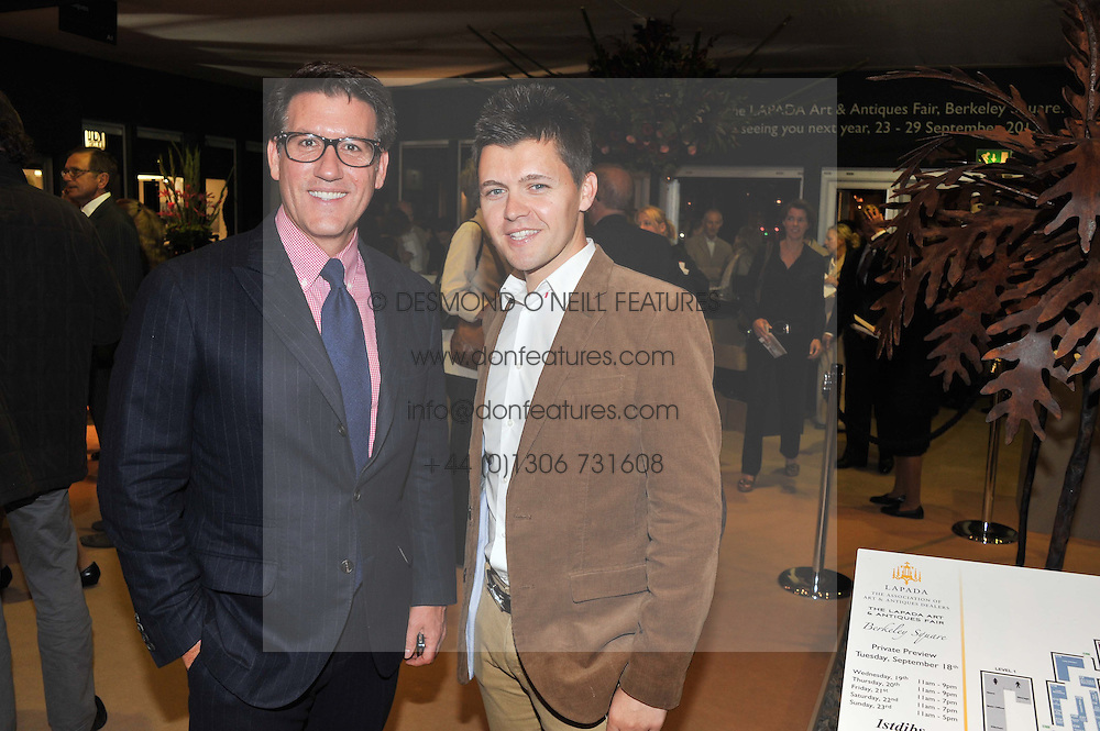 Left to right, MICHAEL BRUNO founder of online luxury marketplace 1stdibs and CARMINE BRUNO (No relation) at a preview evening of the annual London LAPADA (The Association of Art & Antiques Dealers) antiques Fair held in Berkeley Square, London on 18th September 2012.