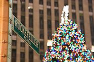 Rockefellre Plaza street sign and Rockefeller Center Christmas Tree, New York city on December 22 2007