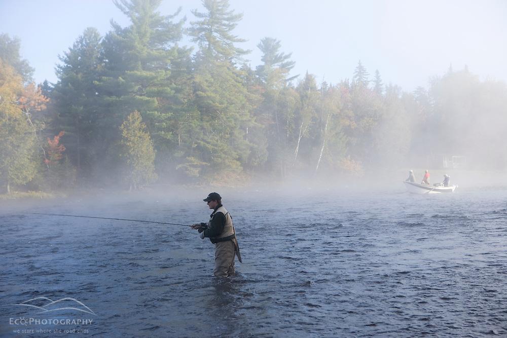 Fly-fishing from a driftboat near Moosehead Lake Maine USA (MR)