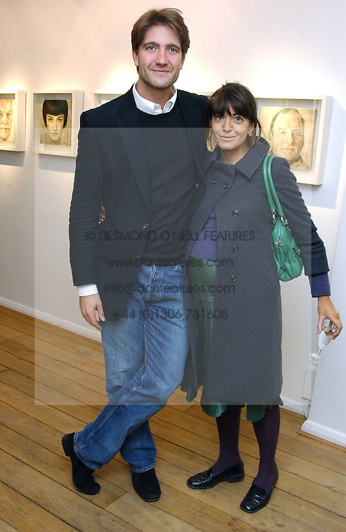KRIS THYKIER and CLAUDIA WINKLEMAN at an exhibition of artist Jonathan Yeo's portrait paintings held at Eleven, 11 Eccleston Street, London SW1 on 16th February 2006.<br /><br />NON EXCLUSIVE - WORLD RIGHTS