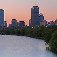 Stunning Boston sunrise skyline photography image of the Charles River, John Hancock Tower, Prudential Center and Citco Sign photographed on a beautiful morning in May 2014. <br />