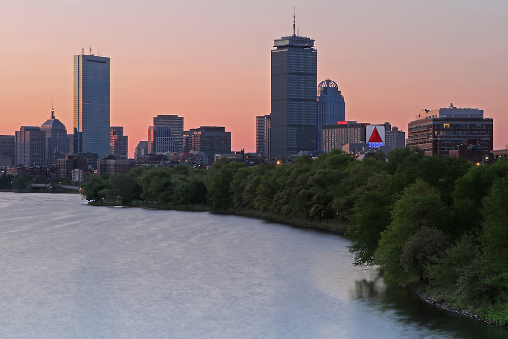 Stunning Boston sunrise skyline photography image of the Charles River, John Hancock Tower, Prudential Center and Citco Sign photographed on a beautiful morning in May 2014. <br /> <br /> Photos from Boston are available as museum quality photography prints, canvas prints, acrylic prints or metal prints. Prints may be framed and matted to the individual liking and decorating needs:<br /> <br /> http://juergen-roth.artistwebsites.com/featured/boston-awakening-juergen-roth.html<br /> <br /> Good light and happy photo making! <br /> <br /> My best, <br /> <br /> Juergen <br /> www.RothGalleries.com <br /> @NatureFineArt <br /> https://www.facebook.com/naturefineart