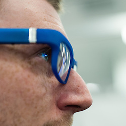 London, UK - 17 March 2014:  a man wears Kopin 101 smart glasses at the Wearable Technology Conference at Olympia in London