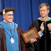 10/21/2011- Medford/Somerville, Mass. -  Tufts President Anthony Monaco shows off the University Charter, keys to Ballou Hall and the Presidential Medal at his inauguration ceremony as the University's 13th president on Oct. 21, 2011. (Kelvin Ma/Tufts University)