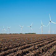 Wind turbines stand in farm fields at the Kleberg County wind farm developed by the Texas Wind Group near Kingsville, Texas.
