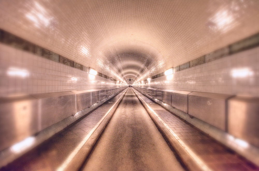 Old Elbe Tunnel or St. Pauli Elbe Tunnel (German: Alter Elbtunnel or St. Pauli Elbtunnel which opened in 1911, is a pedestrian and vehicle tunnel in Hamburg, Germany. The 426 m (1,398 ft) long tunnel was a technical sensation; 24 m (80 ft) beneath the surface, two tubes with 6 m (20 ft) diameter connect central Hamburg with the docks and shipyards on the south side of the river Elbe. This meant a big improvement for tens of thousands of workers in one of the busiest harbours in the world.