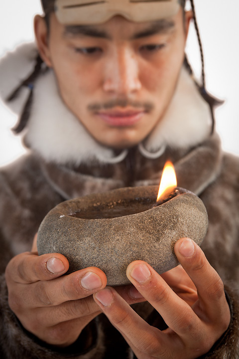 Iñupiat David Thomas with traditional seal oil lamp.
