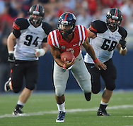 Mississippi quarterback Barry Brunetti (11) is chased by Southeast Missouri State's Travis Sanders (94) and Southeast Missouri State's Jon Slania (68) at Vaught-Hemingway Stadium in Oxford, Miss. on Saturday, September 7, 2013. (AP Photo/Oxford Eagle, Bruce Newman)