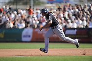SCOTTSDALE, AZ - MARCH 09:  Carlos Quentin #20 of the Chicago White Sox runs the bases against the San Francisco Giants on March 09, 2011 at Scottsdale Stadium in Scottsdale, Arizona. The Giants defeated the White Sox 4-2.  (Photo by Ron Vesely)