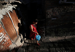 Chinese residents in a slum or shanty town by the Central Business District (CBD) in Beijing, China 19 August 2013.