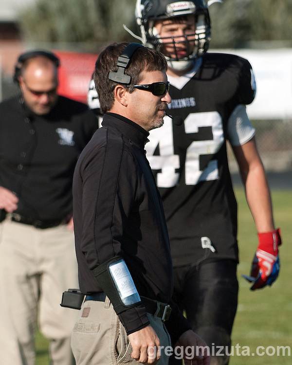 Vale line coach Jeff Jacobs watches from the sideline during the round 1 playoff game against Clatskanie, November 9, 2013 at Frank Hawley Stadium Vale High School, Vale, Oregon. In the background are head coach Matt Hawley and Sage Delong. Vale won 46-0.