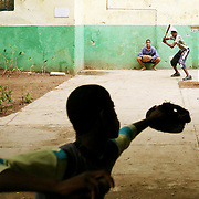Although the 2008 opening day for Major League Baseball is more than a week away in the United States, play goes on year round in Cuba. In the neighborhood of Havana Vieja (Old Havana) boys take to the streets with bats, balls, sticks, worn gloves and all sorts of makeshift equipment to get their daily fix of the game.