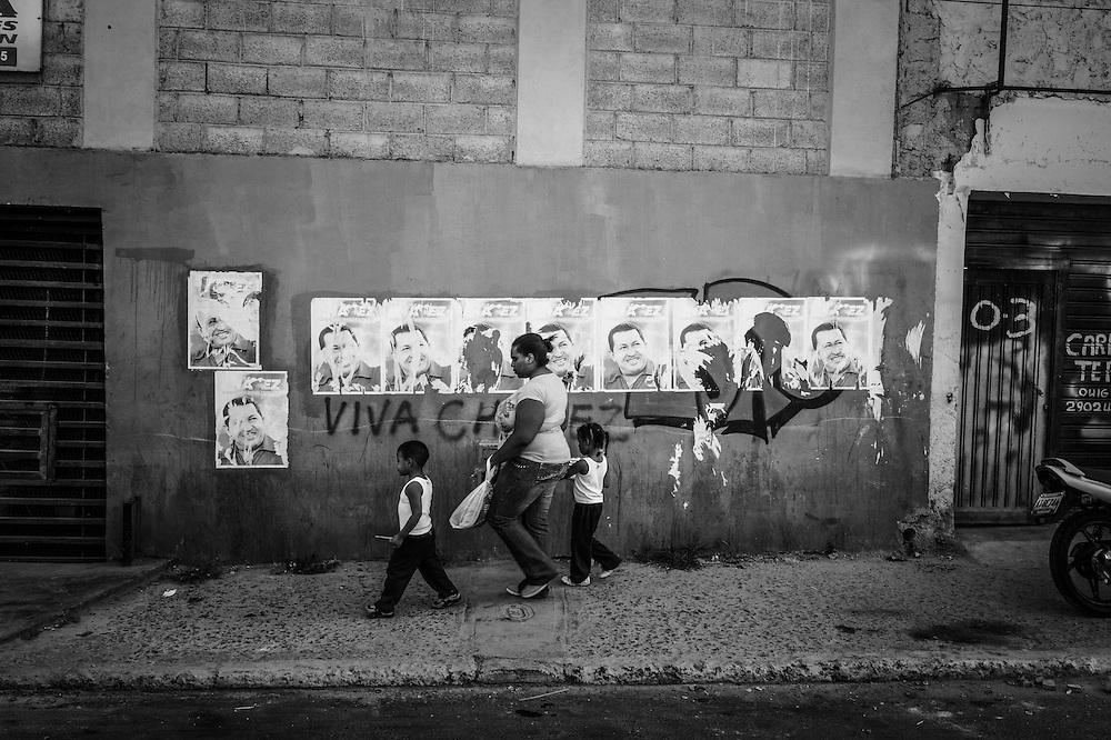 Hugo Chavez campaign posters line the street outside of Sarria nucleo, of the El Sistema music program in Sarria, a  dangerous slum in Caracas, Venezuela.