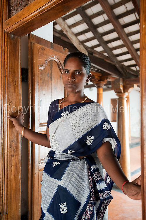 Ms Karai Selvi stands at the entrance to a recently restored house in Tarangambadi (Tranquebar) in South India. Restoration by INTACH