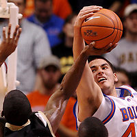 Boise State's Mark Sanchez blocks the shot of Idaho's Kashif Watson in the first half at Taco Bell Arena.