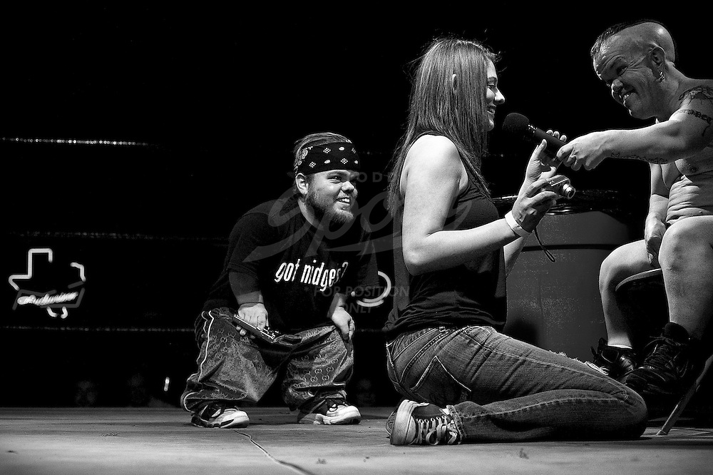 """The Half Pint Brawlers are an eccentric group of self-proclaimed """"Bloody Midgets"""", who travel the world entertaining crowds with their bizarre stage performances...This essay, photographed in January of 2009 features Half Pint Brawlers founder """"Puppet the Psycho Dwarf"""" and wrestler, """"Little Kato""""."""