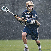 Nick Ossello Midfield/FO #20 looks to pass. The third-ranked Fighting Irish defeated sixth-ranked Duke, 13-5, in men's lacrosse action on a snowy Saturday afternoon at Koskinen Stadium in Durham, N.C.