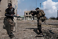 Iraq, Mosul: Iraqi soldiers shooting at ISIS positions in west Mosul. Alessio Romenzi