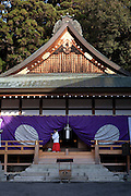 Young female priest cleaning Tado shrine in the morning of the day when Yabusame ritual is performed.