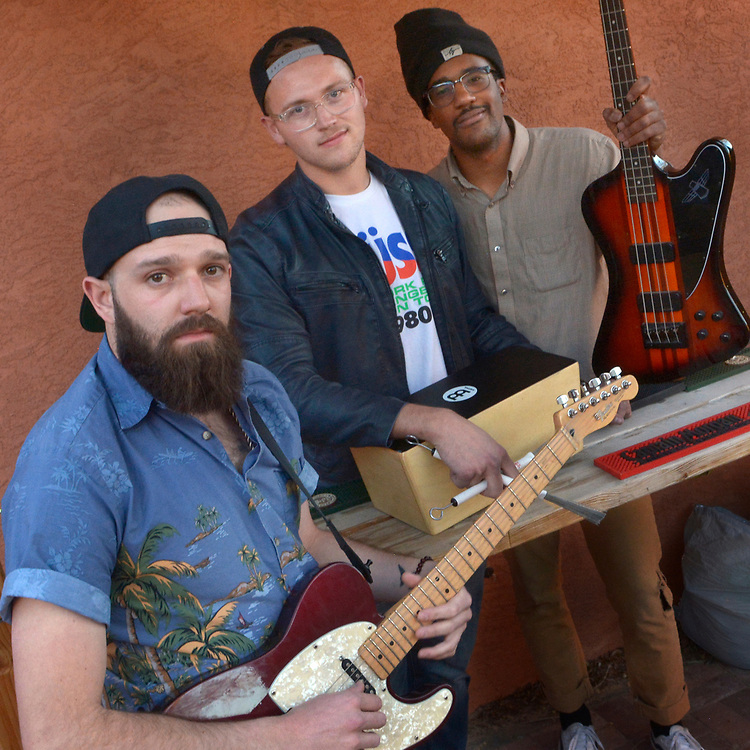 gbs031417v/ARTS -- Manu Sandoval, Zach Spalsbury and Drew Mitchell, from left, are musicians and also  owners of Maple St. Records, a recording studio in their house in southeast Albuquerque. (Greg Sorber/Albuquerque Journal)