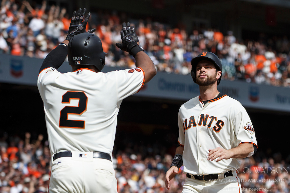 SAN FRANCISCO, CA - OCTOBER 02: Denard Span #2 of the San Francisco Giants and Brandon Belt #9 score on a single hit by Buster Posey (not pictured) during the first inning against the Los Angeles Dodgers at AT&T Park on October 2, 2016 in San Francisco, California. The San Francisco Giants defeated the Los Angeles Dodgers 7-1. (Photo by Jason O. Watson/Getty Images) *** Local Caption *** Denard Span; Brandon Belt