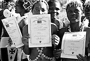 IPLM0034 , South Africa, Venda, June 2001. Young women doing the Domba as part of their initiation rites. King Tshivase gives those who complete the Domba, a certificate and bursary to further their studies.