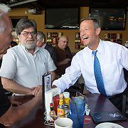 DES MOINES, IA - JUNE 21: Maryland Gov. Martin O'Malley shakes hands with Ben Guise of Des Moines as he meets with Iowa Democratic Party volunteers Saturday, June 21, 2014, during a canvass kick off event at Saints Pub + Patio in Des Moines. (Photo by Scott Morgan for The Washington Post)