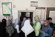 Egyptian women wait in line outside their polling place during the historic democratic Presidential election May 23, 2012 in Cairo Egypt. Coming 15 months after the revolution that toppled the regime of former President Hosni Mubarak, the election will not only decide the leader of the country, but also set the tone and decide the course by which the country moves forward in democracy and reform.  (Photo by Scott Nelson)