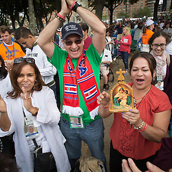 Lisa Johnston | lisajohnston@archstl.org  | Twitter: @aeternusphoto  Viginia Rivas from New Jersey and Javier and Maria Leon of Florida sang Marian chants as they waited for Pope Francis to arrive for the closing Mass of the World Meeting of Families. Some camped out overnight to be near the barriers to catch a glimpse of Pope Francis who will celebrated the closing Mass of the World Meeting of Families in Philadelphia. Crowds are expected to be between 1-1.5 million on the Ben Franklin Parkway.