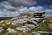 A couple stand on one of the cheesewrings on Rough Tor, on Bodmin Moor