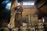 Amir is dedicated to melt metal to make parts for shishaa.