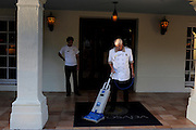 Workers clean up the front porch of the La Posada hotel in Laredo, Texas on August 19, 2010.Hotel occupancy in the city has been sliding since 2005 from 65% to 49% in 2009, and revenue per room collapsed by 23% in the same period, according to data from research firm STR.  Occupancy improved somewhat in the first six months of 2010, but it remains below 60%.