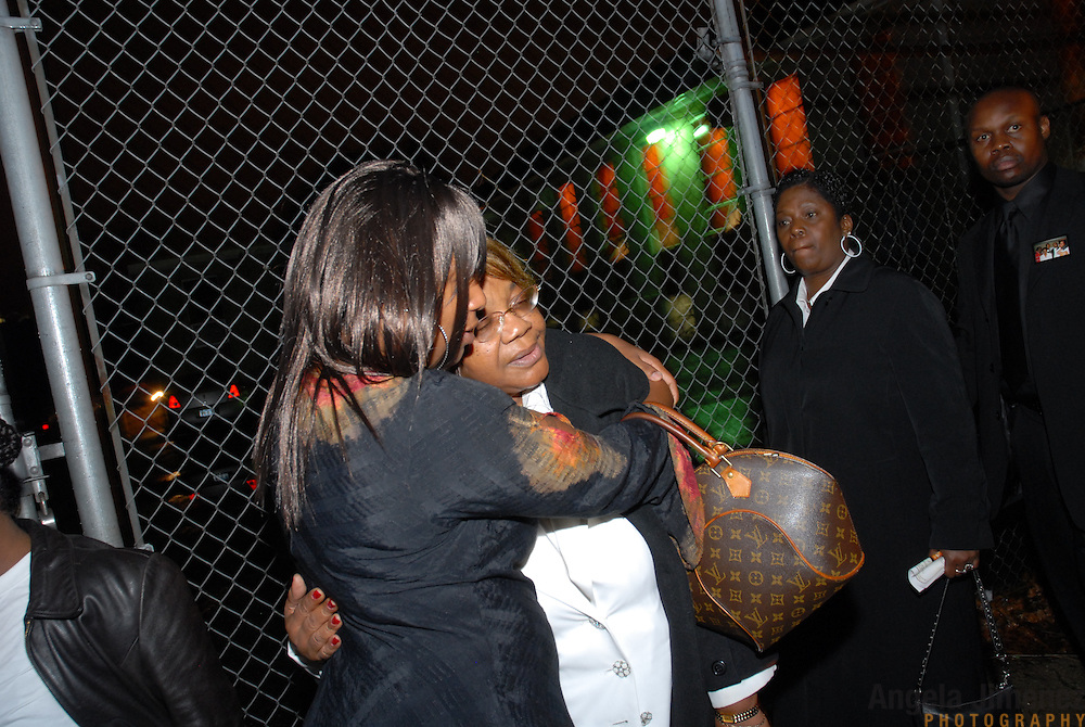 DATE: 12/1/06<br /> DESK: METRO<br /> SLUG: DORISMOND<br /> ASSIGN ID: 30034202A<br /> <br /> Marie Rose Dorismond, right, whose son, Patrick, 26, was killed by undercover New York City Police narcotics detective Anthony Vasquez during a drug buy-and-bust operation on March 16, 2000 in New York City hugs Karen Sturkey, left, as they leave the funeral of Sean Bell, 23, who was killed last week by New York City police officers. Vasquez was acquitted of all charges related to the killing of Dorismond's son. <br /> <br /> Sturkey said she was Patrick's fiancee and she is the mother of one of his children. <br /> <br /> photo by Angela Jimenez for The New York Times<br /> photographer contact 917-586-0916