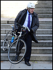 SEP 16 2013 Boris Johnson carrying his bike