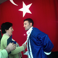 Kafkas University Graduate from Erzurum  being helped by his mother and father (Kemal Akush) to get ready for an official ceremony.