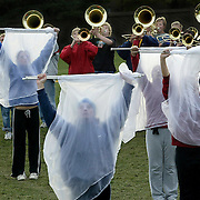"""Looking like ghostly figures, the MOC-Floyd Valley color guard rehearses """"Whirlwind"""" with the band on a cold October morning in Orange City.  The field competition number was conceived and written with effect in mind.  """"We will be creating muscial and visual effects in this year's show that will raise the actitity to a new level,"""" wrote band director Steve Connell in his band camp handbook."""
