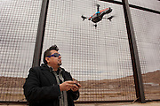 Artist Angel Cabrales at the border fence in El Paso, Texas...La Frontera: Artists along the US Mexican Border...LaFronteraArtistsAlongTheUsMexicanBorder.http://borderartists.com.