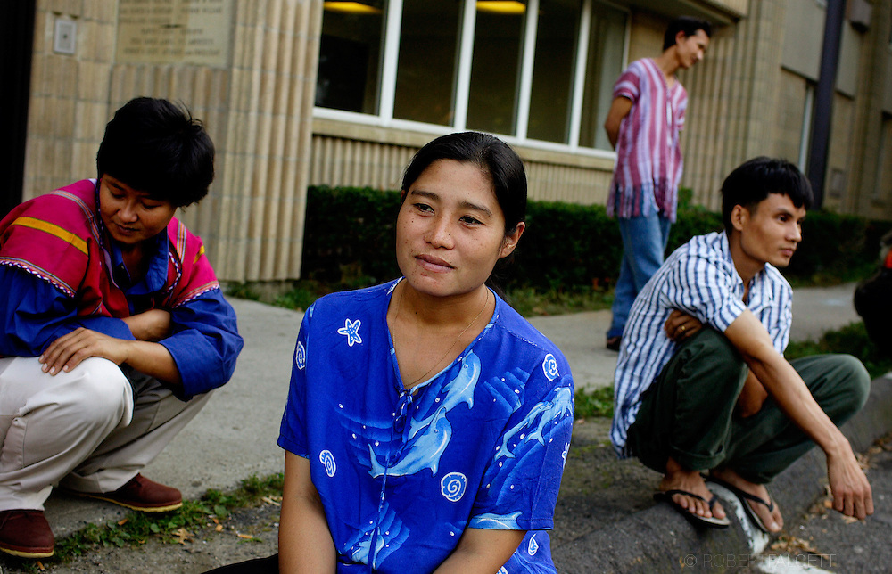 Ethnic Karen people of Myanmar (formerly Burma) from left Lily Paw,32, Anny,34, Taew May Moo,31,and Dabu,28, sit outside the Waterbury apartment complex that is their new home. The group is part of 64 refugees living in Waterbury. .(Photo by Robert Falcetti)