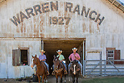 Horses and riders in front of barn at Warren Ranch at Katy Prairie Conservancy; Katy; Texas. Riders left to right are  Brady McDonald; Colby McDonald and Stephen McDonald.
